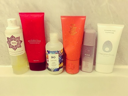 From left to right: REN Moroccan Rose Body Wash, Prismologie The Red Hour Foaming Body Scrub, R+Co Gemstone Colour Shampoo, Oribe Bright Blonde Conditioner, Nude Skincare Detox Fizzy Powder Wash and Omorovicza Cleansing Foam
